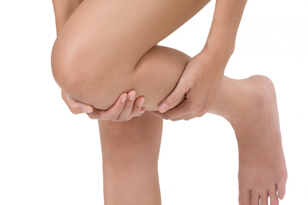 Woman holding her leg with massaging shin pain area isolated on white