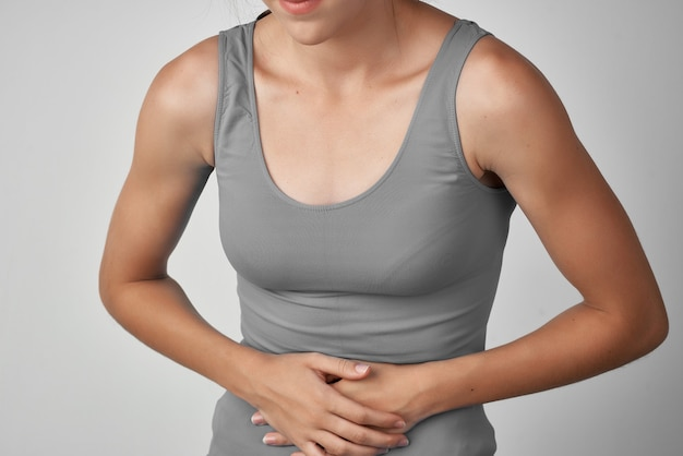 Woman holding her stomach diarrhea abdominal pain