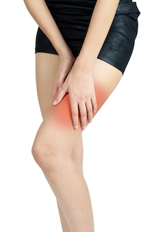 Woman holding her thigh with red highlight in pain area- isolated on white background.