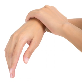 Woman holding her wrist and massaging in pain area isolated on white
