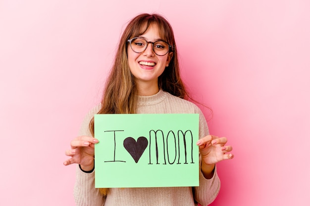 Woman holding an i love mom placard