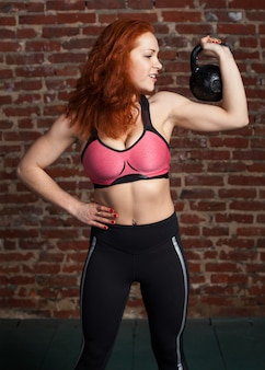 Woman holding the kettlebell