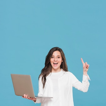 Woman holding a laptop and having an idea