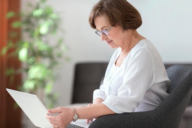 Woman holding laptop medium shot