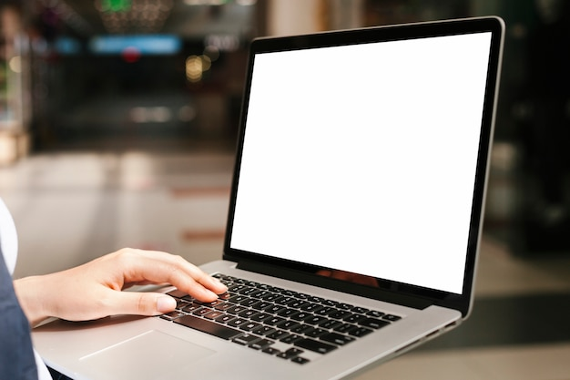 Woman holding laptop mockup