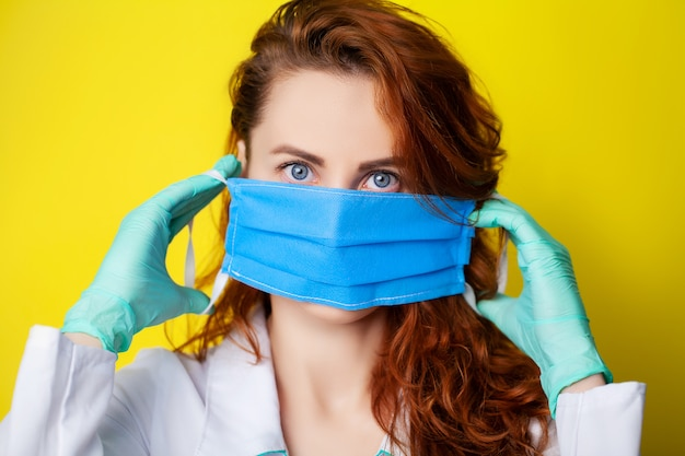 Woman holding mask to cover mouth and nose to protect against virus