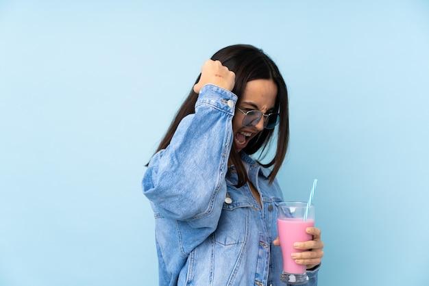 Woman holding milkshake isolated wall