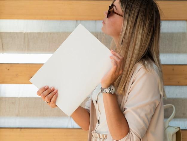 Woman holding mock-up magazine