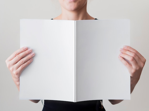 Woman holding a mock-up magazine