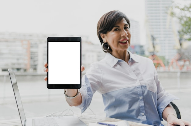 Woman holding a mockup tablet