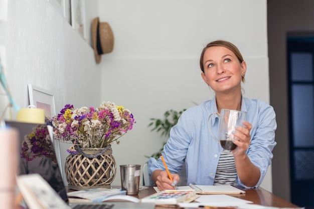 Woman holding mug and thinking