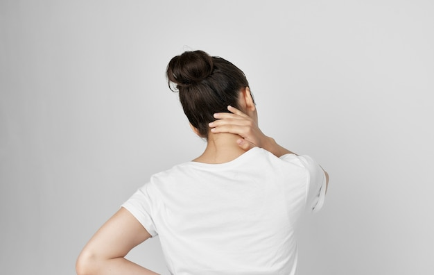 Woman holding neck health problems discomfort medicine treatment. high quality photo