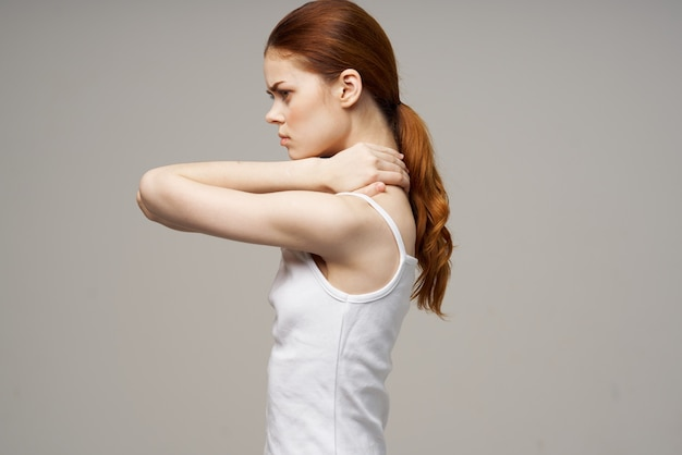 Woman holding on to the neck health problems joint studio treatment