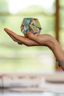 Woman holding an origami object