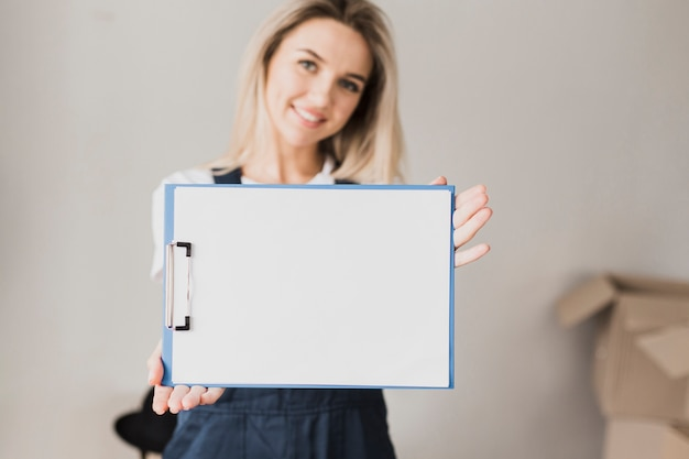 Woman holding paper clipboard with mock-up