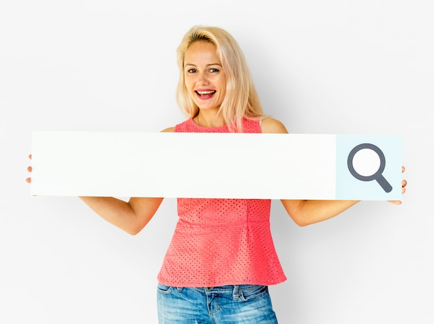 Woman holding paper search bar and smiling
