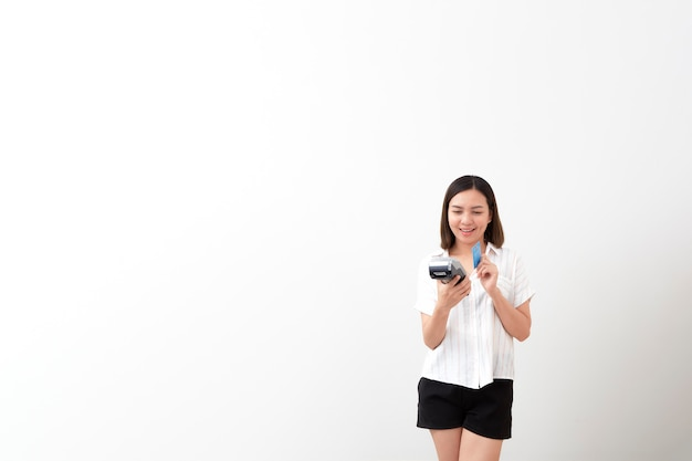 Woman holding payment terminal on white background