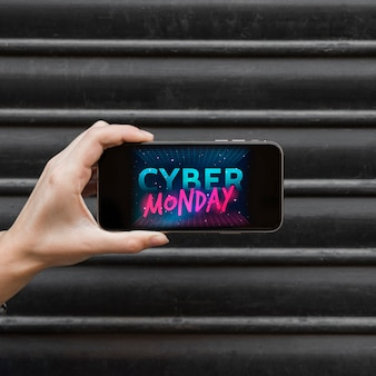Woman holding phone with cyber monday inscription