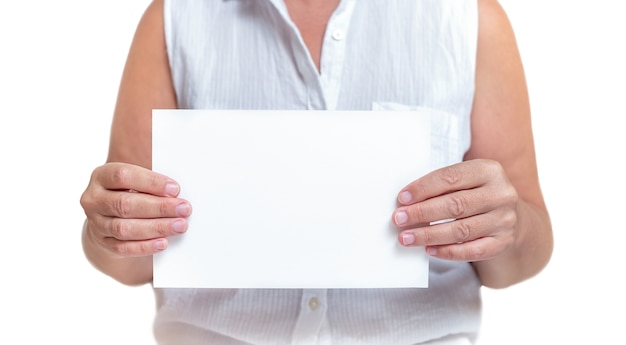 Woman holding piece of white paper with copy space isolated on white background