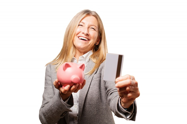 Woman holding pig piggy bank
