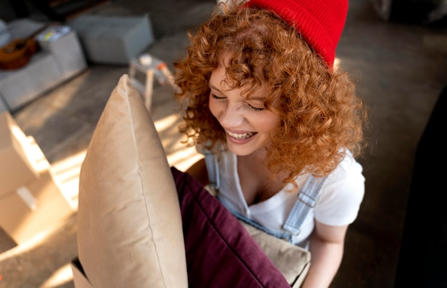 Woman holding pillows for decorating new home