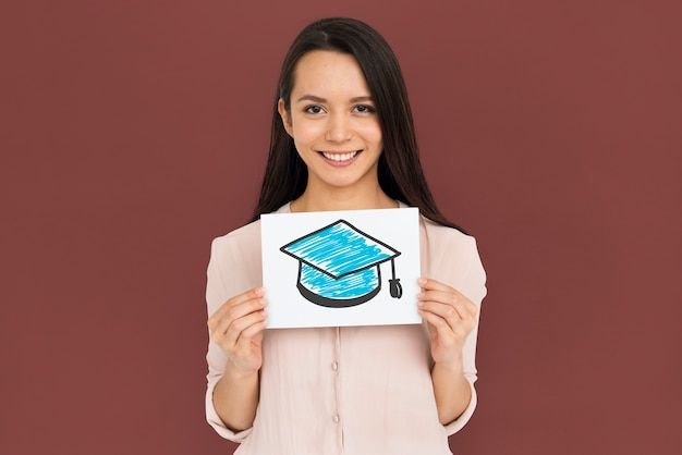 Woman holding placard with mortar board icon