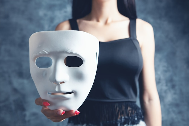 Woman holding a plastic mask