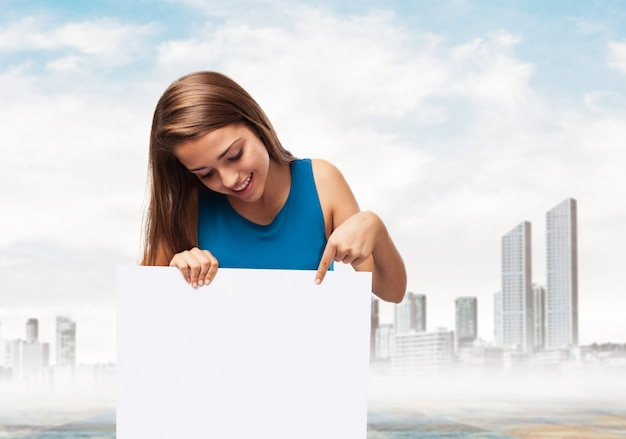 Woman holding a poster with a town background