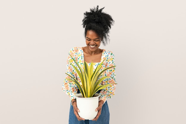 Woman holding a potted spider plant