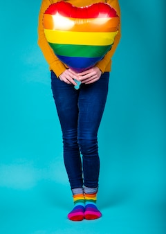 Woman holding a rainbow colored balloon