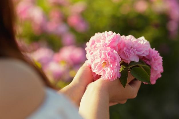 Woman holding roses closeup