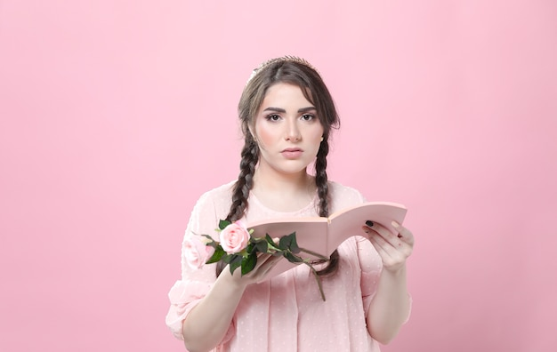 Woman holding roses not impressed by book