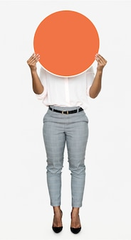 Woman holding a round orange board