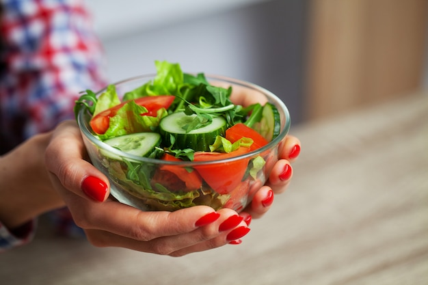 Woman holding a salad in her hands for a healthy lifestyle