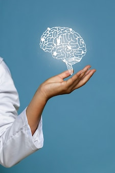 Woman holding shiny brain hologram