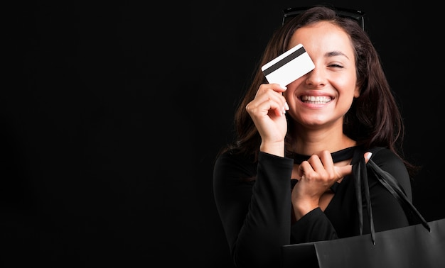 Woman holding shopping bag and credit card