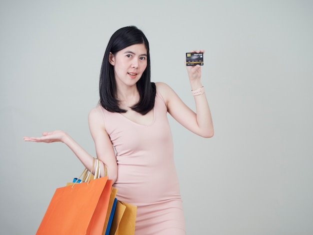 Woman holding shopping bag and credit cards