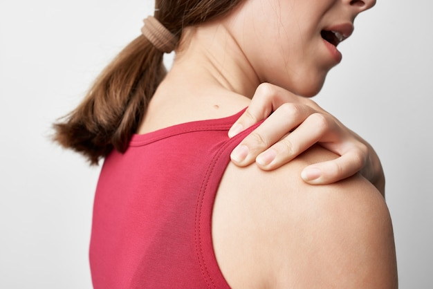 Woman holding shoulder joint problems medicine treatment health care