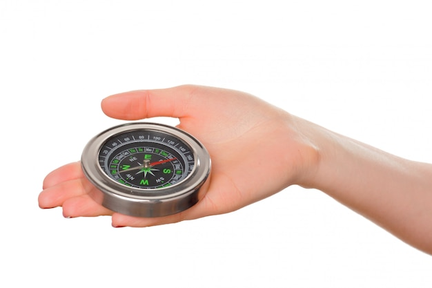 Woman holding small compass. isolated