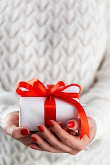 Woman holding small red gift box