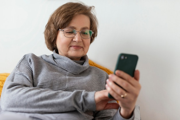 Woman holding smartphone medium shot