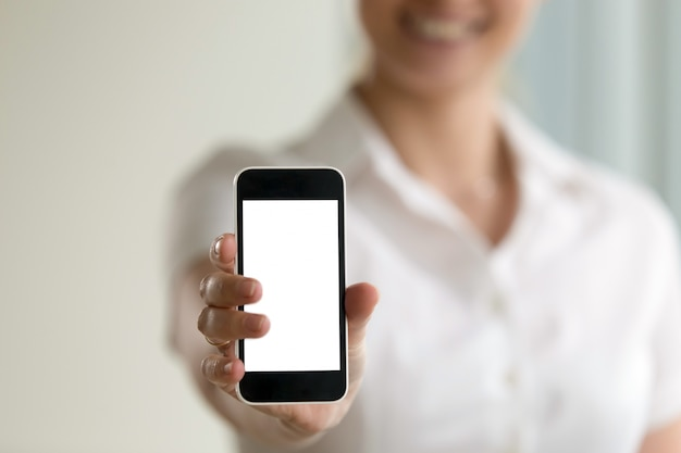 Woman holding smartphone, mockup screen for mobile ads, copy space