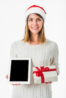 Woman holding tablet and gift box