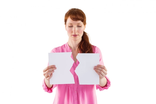 Woman holding torn sheet of paper