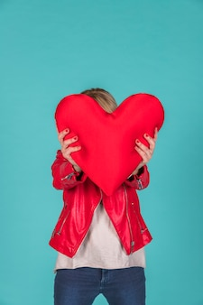 Woman holding toy symbol of heart