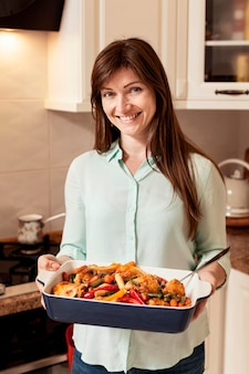 Woman holding tray of food for dinner