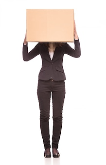 A woman holding up a box in an office.