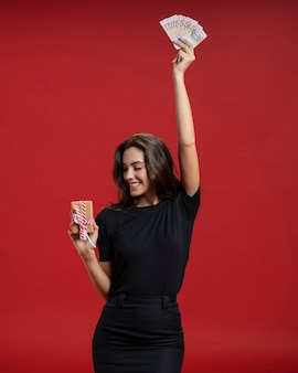 Woman holding up some money
