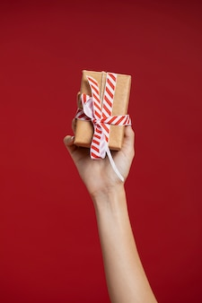 Woman holding up a wrapped gift