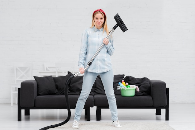 Woman holding vacuum cleaner